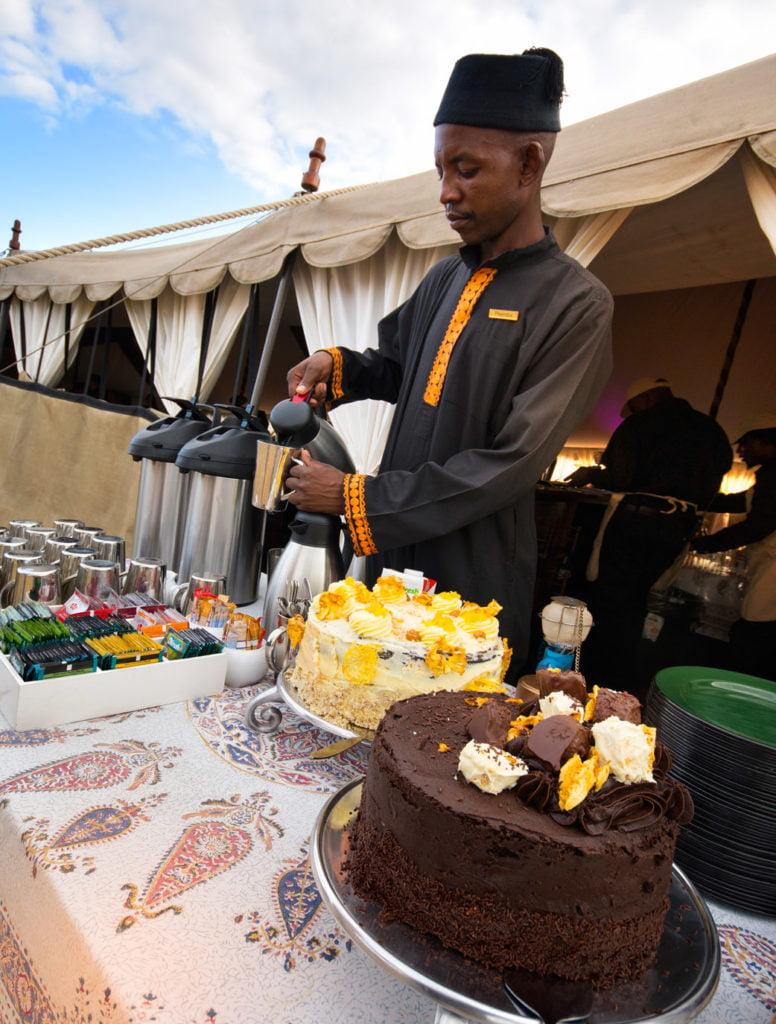 Safari butler at high tea in the African bush